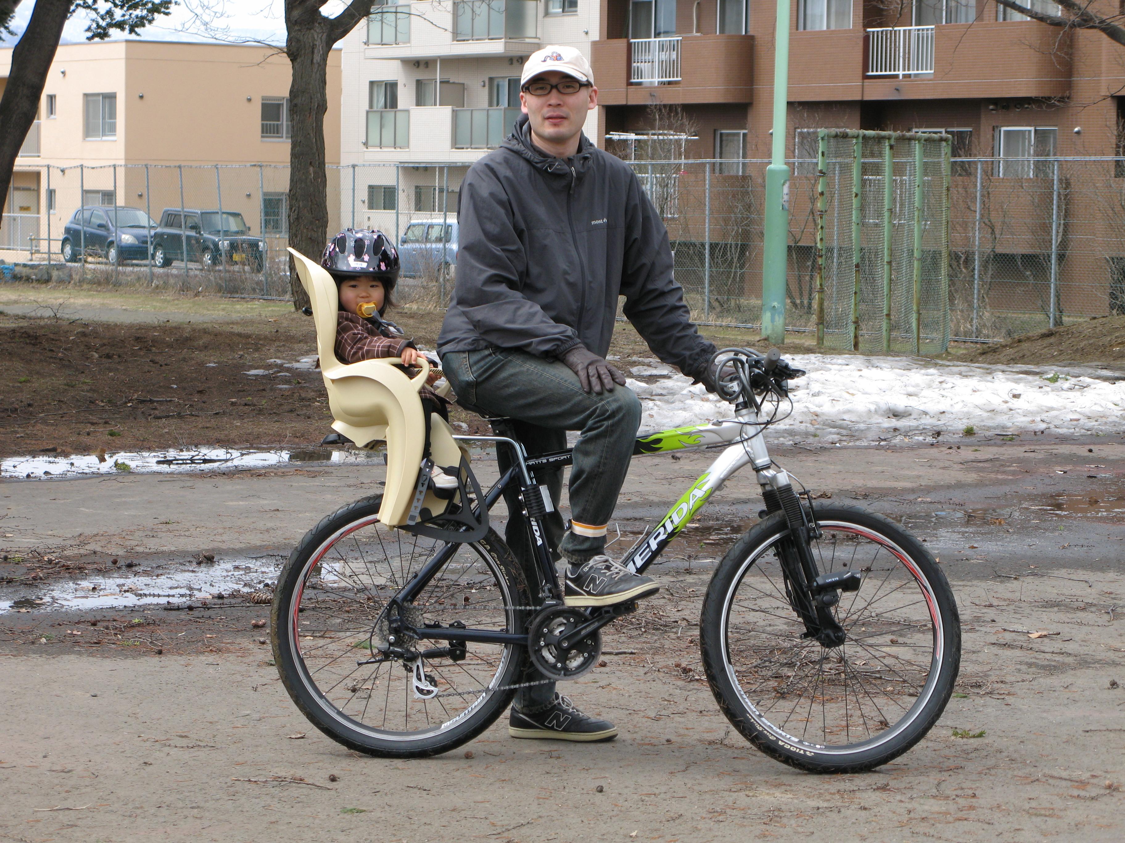 A child in a rear bike seat